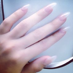 Clear almond shaped nails , natural looking