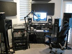 Home recording studio with multiple monitors