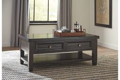 Inspired by the timeless appeal of American classic furnishings—where clean lines, sturdy silhouettes and thoughtful detailing speak volumes—Townser coffee table revisits tradition in style. Rough milled pine is naturally textured and enhanced by a deep finish with gray undertones. Dual drawers and shelf storage make Townser all the more functional.