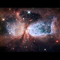 December 15, 2011 the bipolar star-forming region called Sharpless 2-106 looks like a soaring celestial snow angel