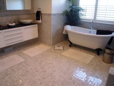 Artistic Tile: Basketweave in Bianco Carrara with Bardiglio is featured on the floor