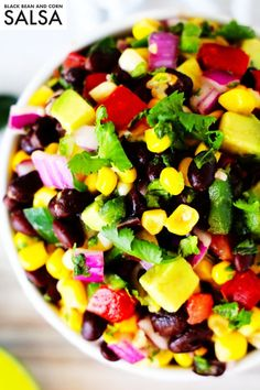 Black Bean and Corn Salsa is exploding with both flavor and color, and it's a healthy (yet hearty) dip recipe perfect for satisfying any snack attack or feeding a crowd! It comes together easily thanks to canned corn and black beans. Then, in comes the fresh flavors of chopped tomatoes, jalapeños, avocado, and onion. It all takes a turn in one seriously zesty, cilantro-lime dressing, and in less than 15 minutes, it's ready for dipping!