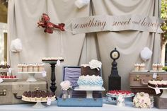 I love the vintage items used in decorating this travel themed dessert table by Sweet and Saucy Shop