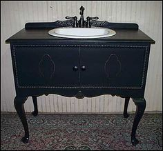 Sideboard repurposed as a bathroom vanity.