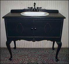 Elegance is an ebonized sideboard repurposed as a bathroom vanity. --MC