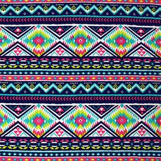 """Bright Diamond Arrow Rows on Navy Cotton Spandex Knit Fabric - Lovely bright colors of teal blue, lime green, fuchsia pink with navy in an ethnic rows design on deep navy cotton spandex knit.  Fabric is a mid weight with a nice 4 way stretch, smooth hand.  Diamond measures 3"""".  ::  $7.00"""