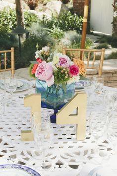 Fun wedding table centerpiece: http://www.stylemepretty.com/california-weddings/2014/09/15/elegant-backyard-brunch-wedding/   Photography: Onelove Photography - http://www.onelove-photo.com/