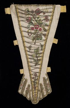 1960.0097 Stomacher, side 1 England, United Kingdom, Europe  Date: 1720-1730  Materials: Silk; Cotton; Metallic thread; Metallic braid  Techniques: Block printed, Embroidered, Woven (plain)