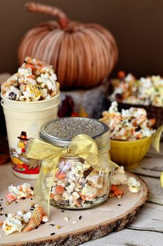 Turkey Munch - Fall Popcorn Snack Mix with bugles, Reeses pieces and sprinkles all drizzled in white chocolate and pumpkin candy melts. Perfect for gifting or at childrens table on Thanksgiving Recipe at Tidymom.net