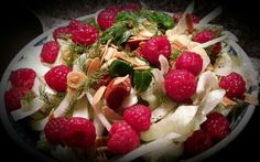 Fennel, Iceberg salad, dried tomatoes, toasted almonds, fresh mint, dill and raspberries with citronette and giger sauce.