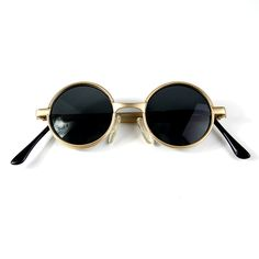 Small round retro Victorian Goth Steampunk sunglasses spectacles typical Ozzy Osbourne style. These glasses are a very small fit. Please read the measurements below very carefully before purchasing. The frame measures 120mm from hinge to hinge, and measures 125mm  from temple to temple. Lenses measure 38mm in diameter. 18mm bridge. The temples are 110mm till curving point. Lenses are poly carbonate with