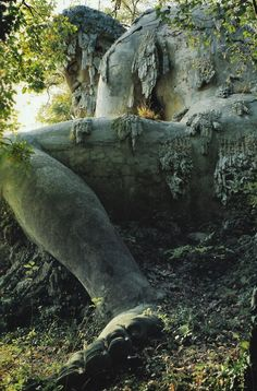The Apennine Colossus by Giambologna  Located in Villa di Pratolino in Tuscany, Italy, which at one point contained a cave, grotto, and multiple water pipes that would spray visitors.