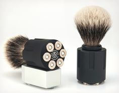 SIX SHOOTER SHAVE BRUSHES  If your looking to take your shaving experience to the extreme, and you've already messed around with razors that have more blades than a samurai movie, check out these Six Shooter Shave Brushes. Each of the handcrafted brushes is made in the US and features authentic shell casings. The revolver body is crafted from high grade anodized aluminum and the removable 20mm brush is composed of fine badger hair. $149