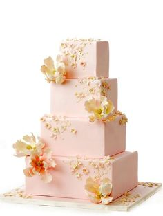 Square tier wedding cake in pink and pale orange.