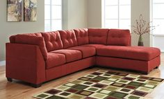 Maier Sienna 2-Piece Sectional Sofa - The Contemporary Style. Add flair to your living room with this contemporary sectional sofa in a red color. Spacious luxury for four including a chaise lounge. Tufted, pillow backs and plump seats for comfort. Double stitch accents through out for a stylish touch. Practical microfiber upholstery. Grand Home Furnishings | K6174