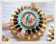 Handmade paper rosette with vintage bird bottlecap   Flickr