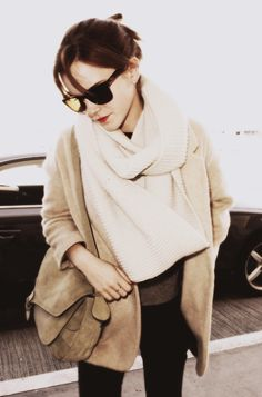 Emma Watson: minimal and classic // Love the cream scarf layered over the camel jacket.