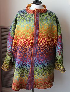 This coat is my own design. I charted out a traditional Scandinavian motif I found in an old Norwegian book of mittens and socks and I'm using the rainbow yarn for both the foreground and bac...