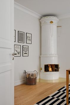 swedish tiled stove masonry heater | interior design + decorating ideas ~ jack                                                                                                                                                                                 More