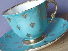 Antique Aynsley tea cup and saucer set, blue tea cup set, blue and gold fleur de lis tea cup, English tea set, bone china tea cup Tea Cup Set, My Cup Of Tea, Cup And Saucer Set, Tea Cup Saucer, Tee Set, Antique Tea Cups, Vintage Teacups, Bone China Tea Cups, Teapots And Cups