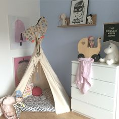 Spotted! Our floral pillow complements the pastel palette in this colorful playroom.