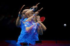 Tianwei Feng of Singapore plays a backhand during the Women's Singles Table Tennis quarter-final match against Kyung Ah Kim of Korea on on Day 4 of the London 2012 Olympic Games at ExCeL on July 2012 in London, England. (Photo by Feng Li/Getty Images) Olympic Table Tennis, Table Tennis Game, Table Tennis Player, Olympic Sports, Olympic Games, Ping Pong Games, Mario, Tennis Match, Multiple Exposure