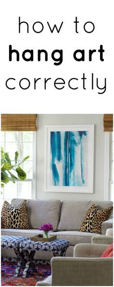 How to hang art correctly   a bright eclectic living room