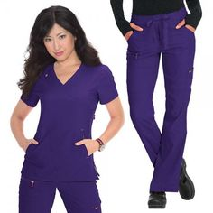 Koi Lite Philosophy Set in Grape, consists of the Philosophy Top paired with the Peace Trousers. This set is lightweight, moisture wicking, wrinkle free and stretchy. £59.99 #setscrubs #scrubs #uniforms #nursescrub #purplescrubs #medicalscrubs