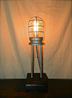 Industrial Steampunk Style table lamp made from vintage Crouse Hinds cage light.