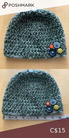 "Green handmade toque DESCRIPTION Deep green and grey multi coloured crochet toque suitable for young child, around 2 to 5 years. Fun buttons along the band and one on the top complete it.   SIZE: 2 to 5 years 8"" laying flat unstretched  FABRIC: 100% acrylic  CONDITION: Comes from SMOKE-FREE, CAT-FRIENDLY home 9/10: Excellent condition! Accessories Hats"