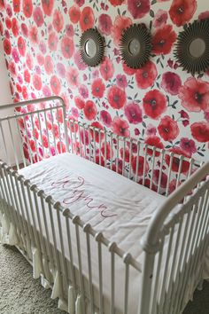 Amazing wall decor + Carousel Designs personalized crib sheet! Love this nursery.