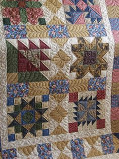 This is from Thimbleberries Quilt Club 2004.  I have it ready to quilt.  It's beautiful :)