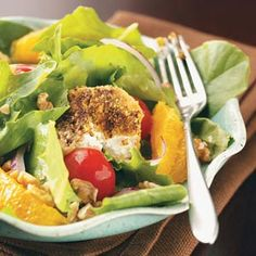 """Salads with Pistachio-Crusted Goat Cheese - Looking for something a little different for supper? """"This vegetarian main-dish salad pairs walnuts, juicy oranges and tomatoes with warm, pistachio-crusted goat cheese medallions and a splash of vinaigrette,"""" says Gloria. Serve with a crusty loaf of French bread. Gloria Bradley - Naperville, IL"""