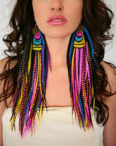 Crazy, crazy kaleidoscope feather earrings that look like hair extensions. YES!