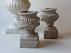 Two cement urns by unpotpourri on Etsy, $36.00 #design #handmade #etsy