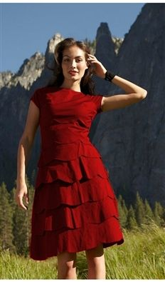 Tiers of scalloped ruffles untangle to create this deep red dress. With simple cap sleeves and a back zipper, this dress is the perfect dialectic of elegance and playfulness.  Made from a woven cotton poplin/spandex blend, this dress is also easy to wear and easy to pack.