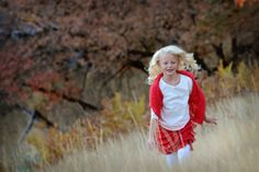 www.frostedproductions.com | #utah #child #photographer #red #and #white #eight #year #old #girl #natural #light #sunflare #fall #leaves #running #in #a #field