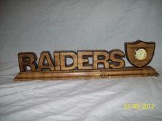 Scrolled saw Raiders  clock