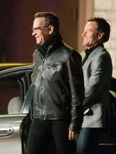 Tom Hanks Larry Crowne Chocolate Brown Leather Outfit    Jacket Features:Outfit type: Genuine Leather JacketGender: MaleColor: BlackFront: Front Zip ClosureCollar: Shirt Style CollarLining: Viscose LiningCuffs: Zip CuffsPockets: Two Zip pockets on Front & Two inside pocke