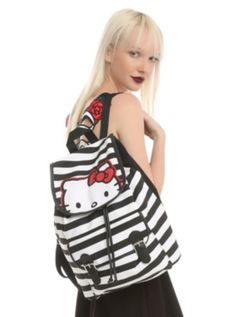 d9528cd5a8f Black and white striped slouch backpack with a Hello Kitty face design on  the flap and a front pocket.