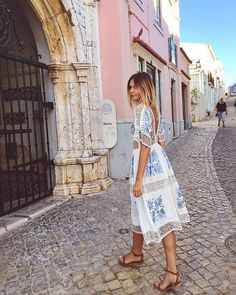 Loose-fitting dresses are both comfortable and chic for your next jet-set adventure.
