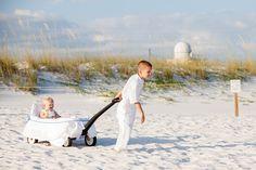 beach wedding, flower girl alternative : ring bearer pulling wagon down the aisle!  Destin, FL  Amy Little Photography