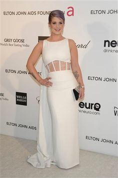 Kelly Osbourne carries Swarovski's black satin and crystal envelope Midnight clutch at the Elton John AIDS Foundation Academy Awards party at the Pacific Design Center in West Hollywood on Feb. 24, 2013. || Dan Steinberg / Invision / AP