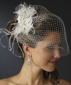 Beautiful wedding veils. Simple to elegant, with lace trim, crystals, pearls or birdcage style, even all lace viels. Shoulder length veils, fingertip length veils, long veils and Cathedral length veils. Bridal veils that will please the pickiest bride.
