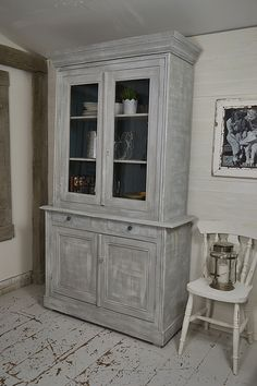 We've given this antique French buffet a complete transformation using a dry brushing technique, using Annie Sloan Old White over Paris Grey. Inside we've painted in Annabell Duke Tom's Boatyard', lightly distressed and sealed with clear wax. Why not add some rustic French style to your kitchen? http://www.thetreasuretrove.co.uk/kitchen-storage/shabby-chic-grey-and-white-french-kitchen-buffet