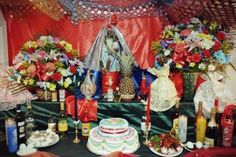 This picture depicts decorated a Voudou alter from Haiti. Here the followers are attempting to contact a spirit. The picture has been taken within the last few years in Brooklyn showing that Vodou lives on.