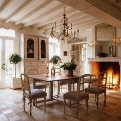 Toscana Clean and bright dining room with beamed ceiling and stone fireplace.
