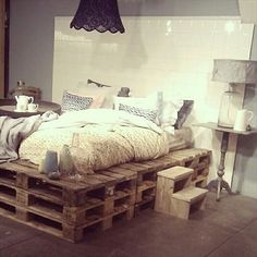 9 Ways to Create Bed Frames Out of Used Pallet Wood - Pallet Furniture I like the tall platform look this has but I would need space I. The center to put my box spring :/