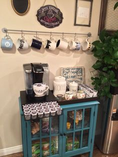 A cute idea for any coffee lover.  Fully Stocked Coffee Bar.  Target Threshold Windham Accent Cabinet, Keurig Coffee Maker, IKEA BYGEL Rail, silver color.
