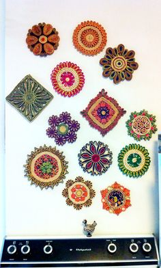 These are straw trivets I have collected and found at different stores. I decided to turn them into wall decor and hang them above my stove. So CUTE!